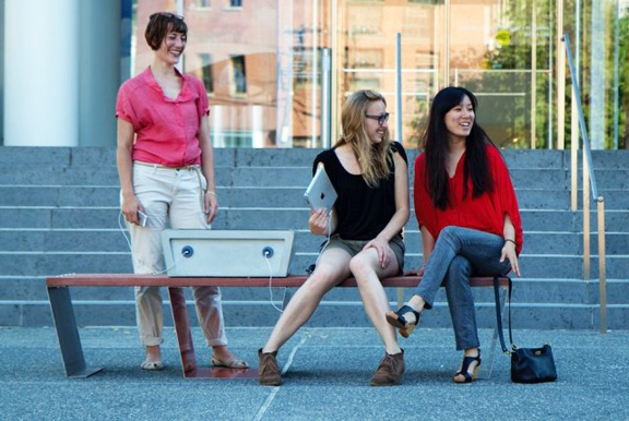 Solar powered benches for parks with built in solar charging station