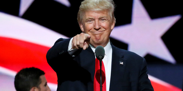 Republican presidential nominee Donald Trump points at the gathered media during his walk through at the Republican National Convention in Cleveland